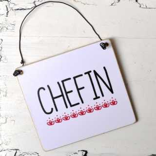 Holzschild mit der Aufschrift CHEFIN