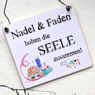 Schild NADEL & FADEN halten die SEELE zusammen