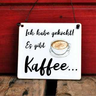 Schild mit Spruch Ich habe gekocht, es gibt Kaffee