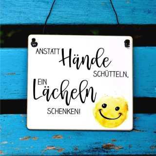 Schild Anstatt Hände schütteln ein Lächeln schenken