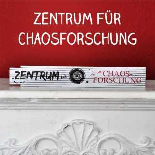 Zollstock mit Spruch Zentrum für Chaosforschung