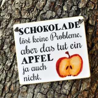 Schild mit Spruch SCHOKOLADE LÖST KEINE PROBLEME